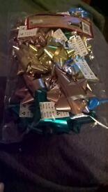 69 packs of 25 self adhesive bows