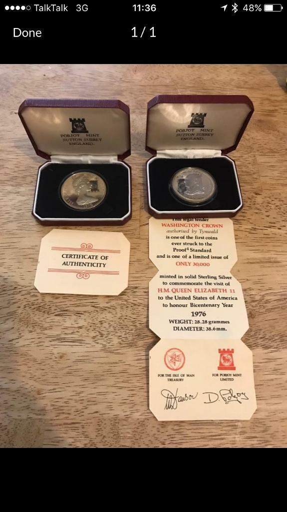 A pair of solid silver 1976 Washington one crown in boxes