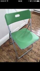 Green folding chair