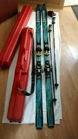 Skis and bindings and poles and case