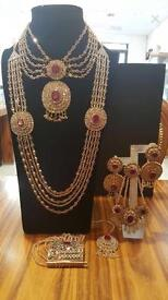 gold and ruby red bridal jewellery set £300