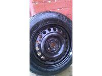 nearly new black steel corsa wheel & tyre