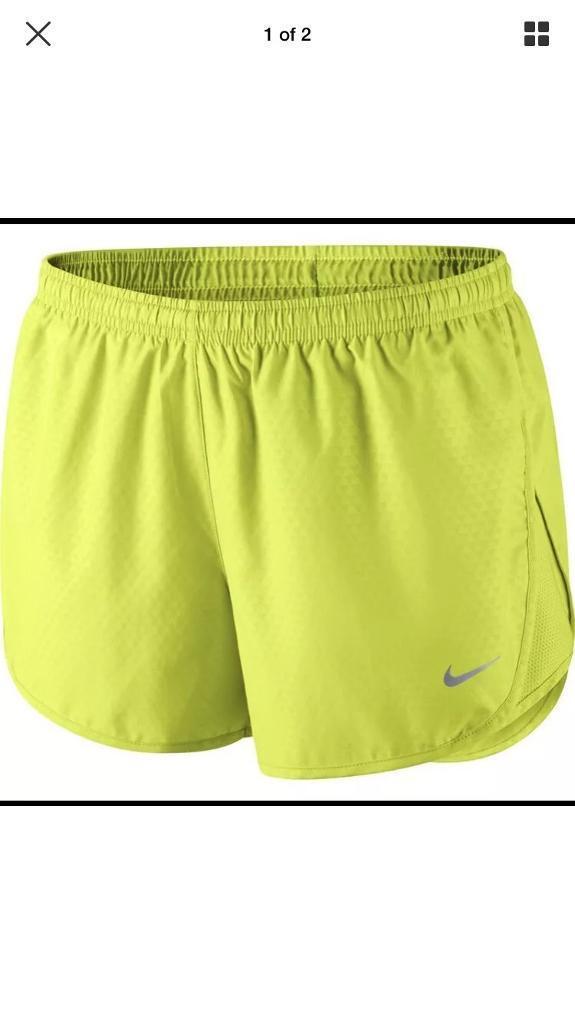 Women's Nike Medium shorts. Yellow