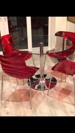 Glass table & four chairs