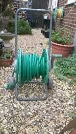 Garden hose on wheeled cart