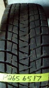 One like new Bridgestone Blizack 265 65 17 winter tire.
