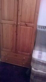 Single pine wooden wardrobe