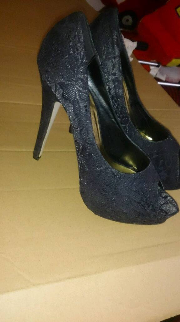 New, black lace high heels. Size 8.