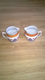beautiful pair of cream jugs