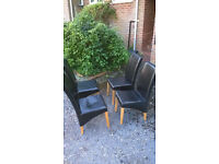 Set of 4 faux leather dinning room chairs.