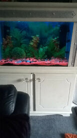 large fish tank in solid wood unit