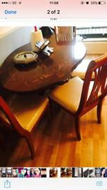 Solid wood dining table and four chairs £140