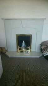 White stone effect fire place with electric fire