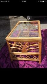Cane table with glass top. £8.00