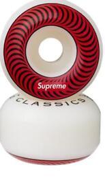 Red supreme wheels skateboard