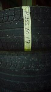 Two Michelin 255 60 19 winter tires.