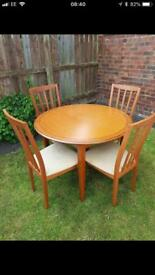 Extendable dining room table. X4 chairs. Just enquire regarding sizes