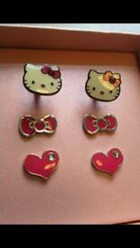 HELLO KITTY SETS OF 3 STIRLING SILVER EARRINGS, boxed and new!