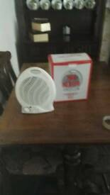 2 Argos fan heaters as new both with variable speed & fan assisted