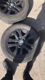 Set four bmw 1 series alloys in black good tyres still legal