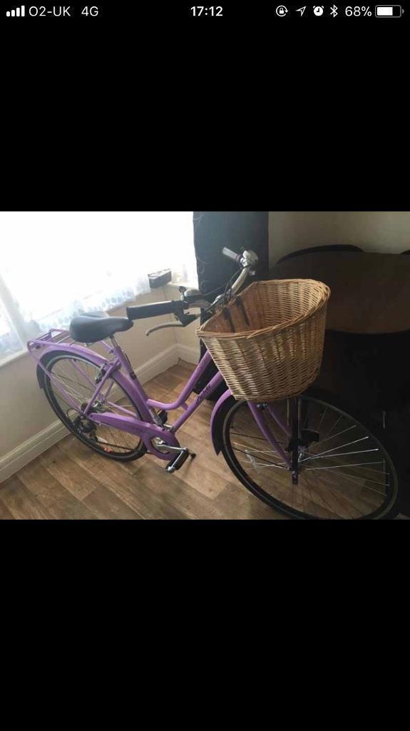 Women's purple bike with basket