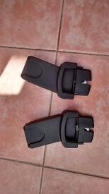 Adapters to allow Maxi Cosi Car seat to attach to Oyster pram frame.