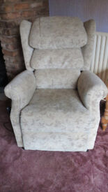 Riser recliner chair and matching two seater sofa.