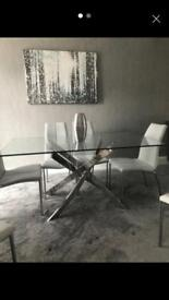 GLASS/STAINLESS STEEL DINING TABLE £200