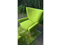 A New Designer Lime Green Upholstered Winged Back Arm Chair and footstool.