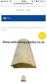Log lap cladding pressure treated