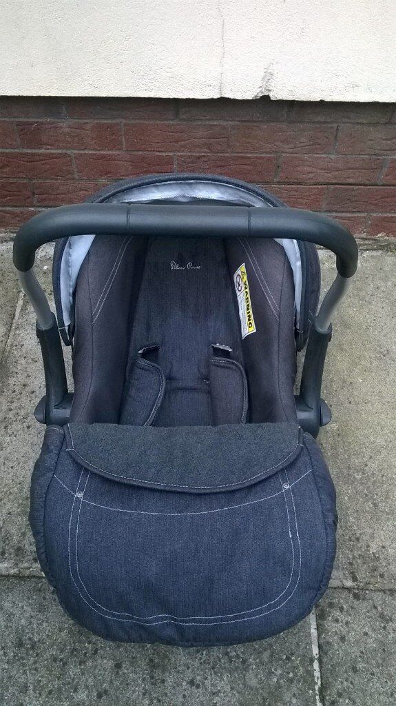Car seat with hood and foot muff.
