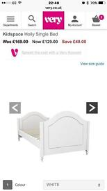 White single bed and mattress