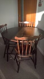 Wooden dining table and chairs good condition circular and extendable