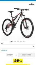 B-twin dual suspension mountain bike .