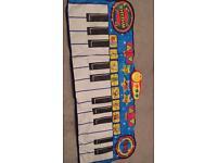 Giant keyboard play mat