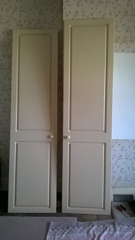 "FREE 5 MDF cream wardrobe doors 81 3/4"" X 20 3/4"" approx. 2 pairs one single one with mirror inside"