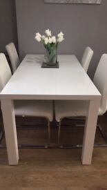 White dining table only not chairs fits 4-6 chairs brilliant condition!