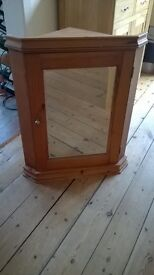 Mirror door wooden corner cupboard with mountings.