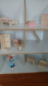 dolls house with few bits of furniture