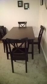Extending dining table and four chairs, excellent condition.