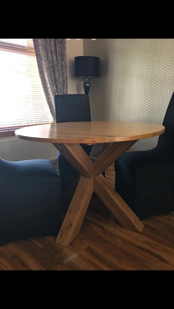 Next solid oak dining table