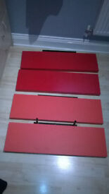 4 Red Floating Shelves with hidden brackets.
