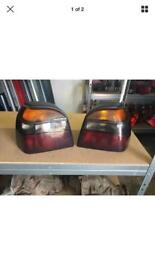 VW GOLF GTI MK3 SET OF SMOKED REAR LIGHT ASSEMBLY INC BULB HOLDERS VW PART NUMBER: 1H694257/258