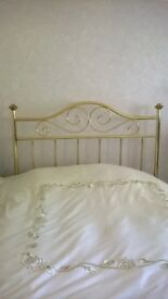 A brass bedstead to fit a 4ft 6 inch double bed