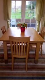 Wooden dining table and 4 chairs with upholstered seats