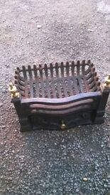Cast iron fire grate and front plate.