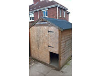 wooden shed converted into dog pen