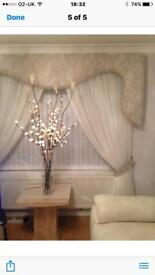 Pelmet and voile curtains with matching tie backs , and a crystal trim