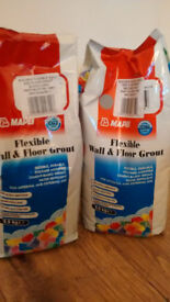2 BAGS OF GROUT... FOR WALL & FLOORS... ONE BAG OF BLACK & ONE GREY