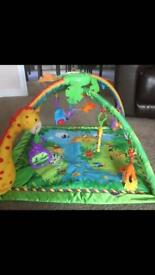 Rainforest jungle playmat by fisher price.